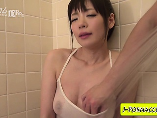 Japanese babe toys her pussy