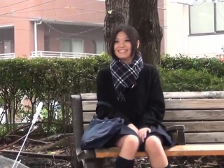 Japanese teen toying impassive