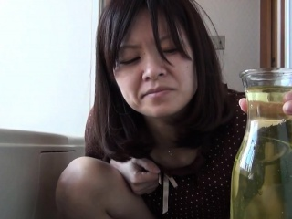 Asian babe pees in pot