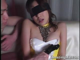 Blindfolded asian newborn..