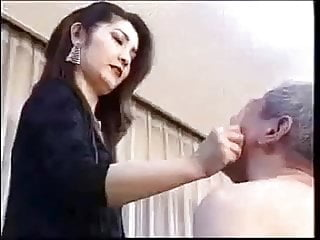 Asian slapping her slave guy