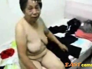 Asian Grandma get dressed stopping sex