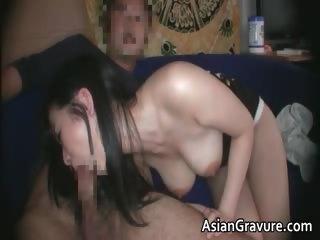 Cute ill-lit asian indulge..